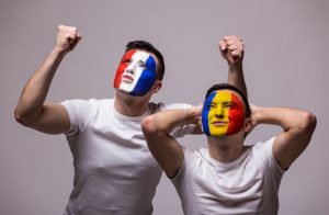 France vs Romania white background. Football fans of Romania and France national teams demonstrate emotions: Romanian lose, France win. football fans concept.
